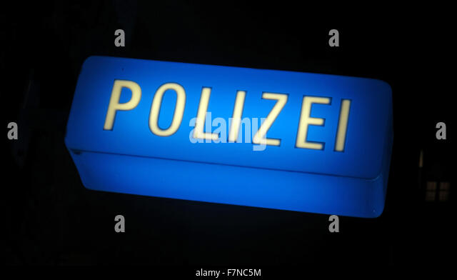 Blue German Police Sign at night - Polizei - Stock Image
