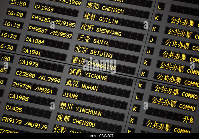 Coach schedule information board in Pudong airport,Shanghai,China. - Stock Image