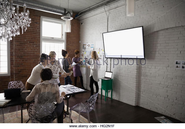 Female designers meeting and brainstorming in conference room - Stock Image