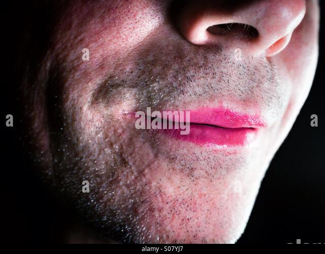 Unshaven man wearing pink lipstick - Stock-Bilder