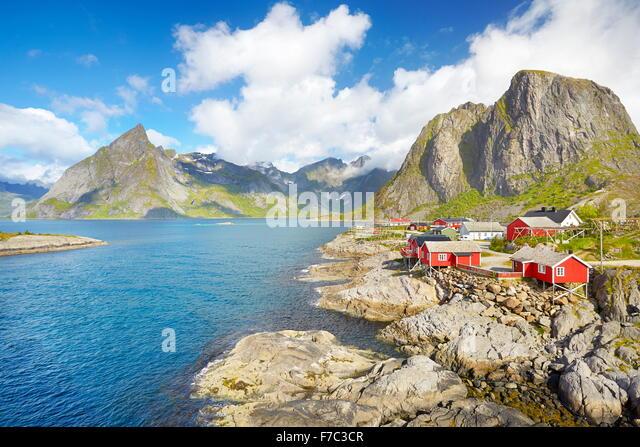 Traditional red wooden fishermen`s huts rorbu, Lofoten Island landscape, Norway - Stock Image