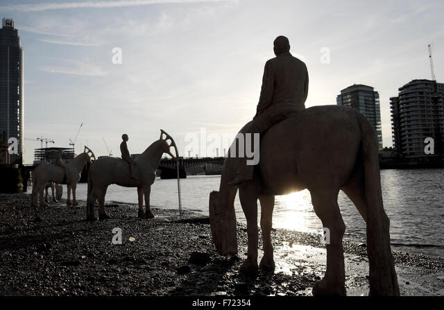 British artist Jason deCaires Taylor horses sculpture 'The Rising Tide'  at low tide on  the Rver Thames - Stock Image
