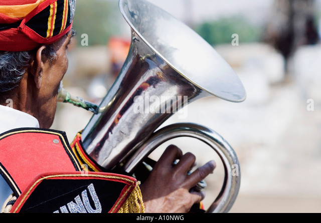 Rear view of a man playing the tuba, Jaipur, Rajasthan, India - Stock-Bilder