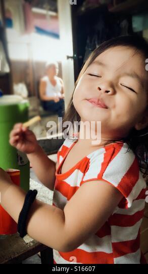 Toddler enjoying fries - Stock-Bilder