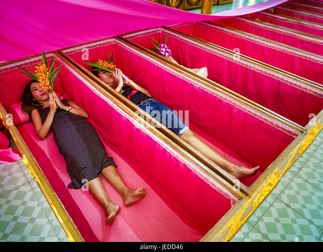 Bang Kruai, Nonthaburi, Thailand. 24th June, 2017. People lay in their coffins during a ''resurrection'' - Stock Image