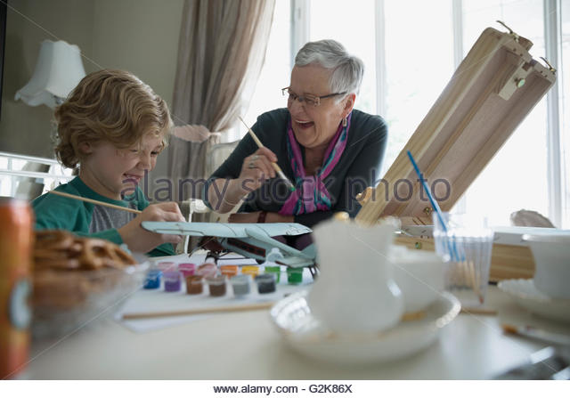 Grandmother and grandson painting - Stock Image