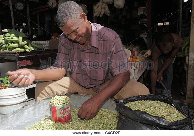 Santo Domingo Dominican Republic Ciudad Colonia Mercado Modelo market marketplace Hispanic Black man vendor fresh - Stock Image