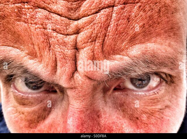 Close up of Middle aged man frowning - Stock Image