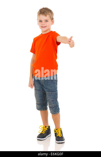 cute boy showing thumb up gesture on white background - Stock Image