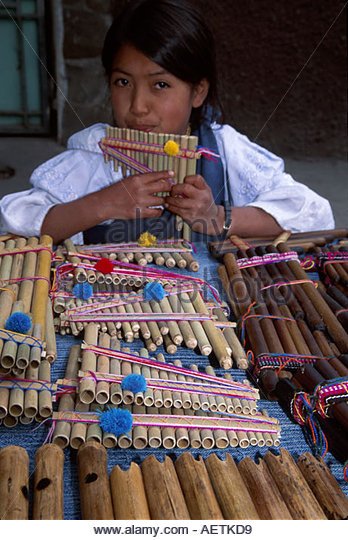 Ecuador Otavalo Market girl rondadore music instruments souvenirs Indigenous natives - Stock Image