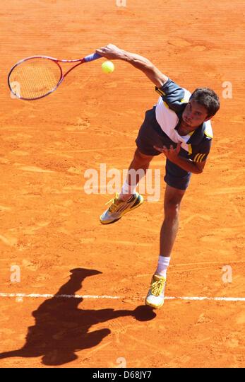 April 15, 2013 - Monte Carlo, Monaco - MONTE CARLO, MONACO - APRIL 15: Gilles Simon of France serves the ball during - Stock Image