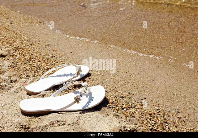 Sandels on the foreshore - Stock Image