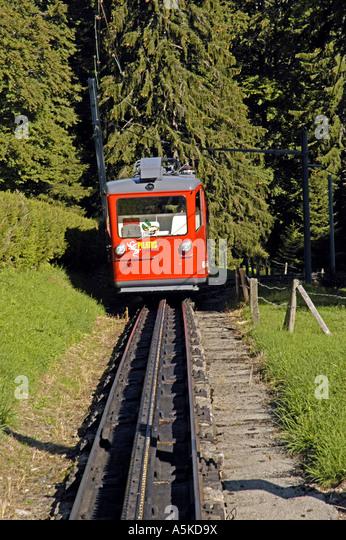 Switzerland Mount Pilatus red tram rail car lucerne luzern - Stock Image