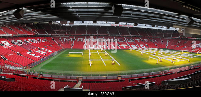 Manchester United pitch with solar lamps on grass turf in winter - Stock Image