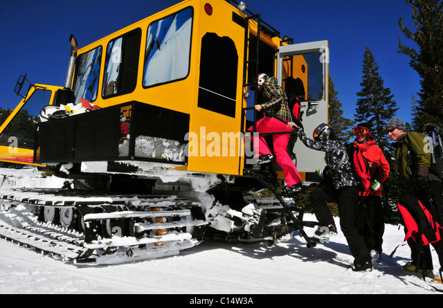 Skiers and snowboarders load into a snowcat at Kirkwood Mountain Resort, CA. - Stock Image