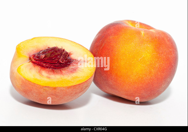 Whole and half peach - Stock Image