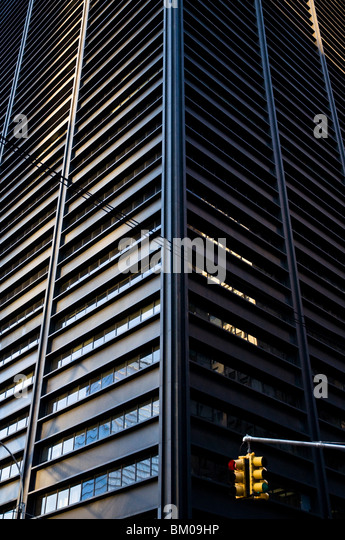 Looking up at a tall skyscraper building in the Financial District of New York. - Stock Image