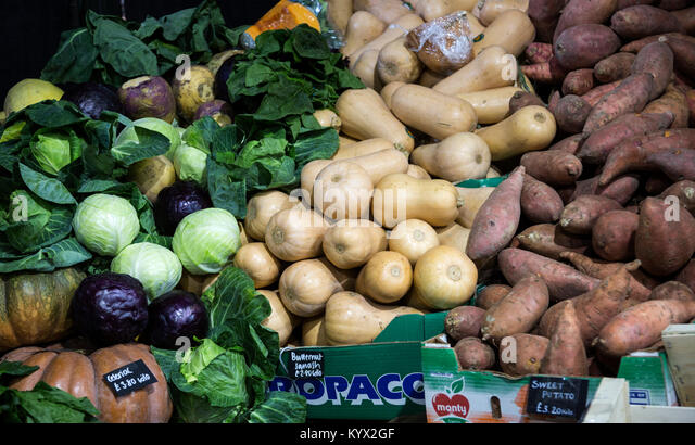 Cabbage, squash and sweet potatoes on sale at a farmers market - Stock Image