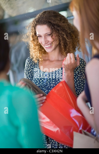 Girl friends on shopping tour - Stock Image