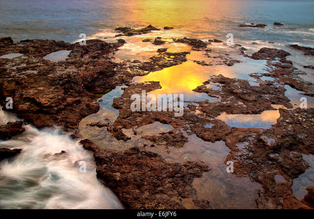 Sunset reflection at low tide. Lanai, Hawaii. - Stock Image