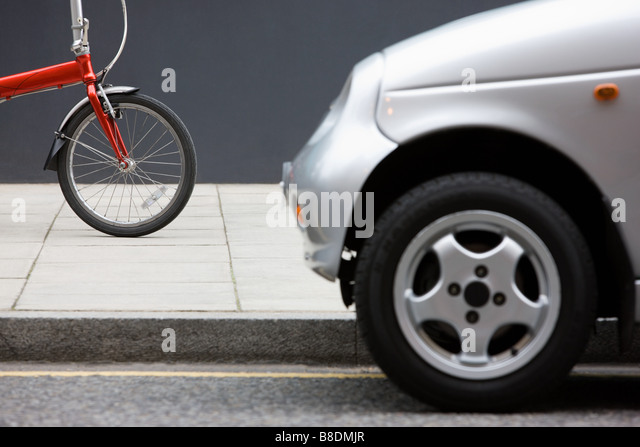 Bicycle and car - Stock Image