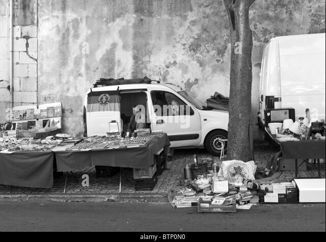 Bored couple at the Feira da Ladra - the 'Thieves' Market', Lisbon, Portugal - Stock Image