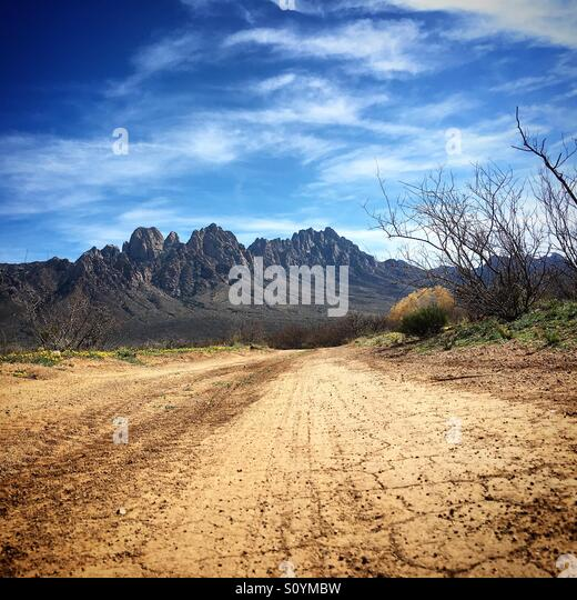 Dirt road towards Organ Mountains - Stock Image