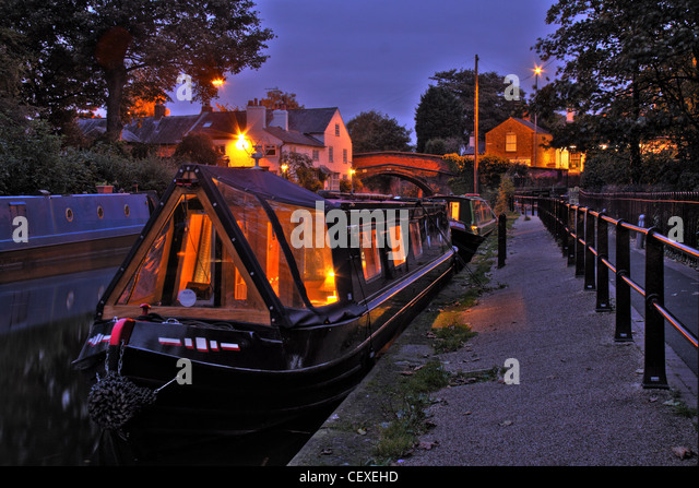 Bridgewater canal Lymm Village moorings, Warrington Cheshire, England, UK at Dusk - Stock Image