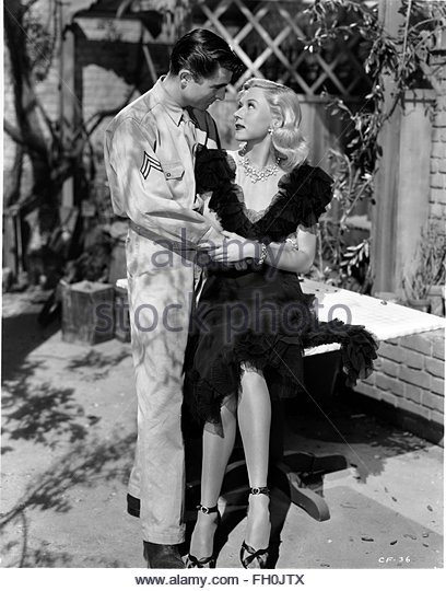 CROSSFIRE (1947) - ,  Gloria Grahame. Courtesy Granamour Weems Collection. Editorial use only. Licensee must obtain - Stock Image