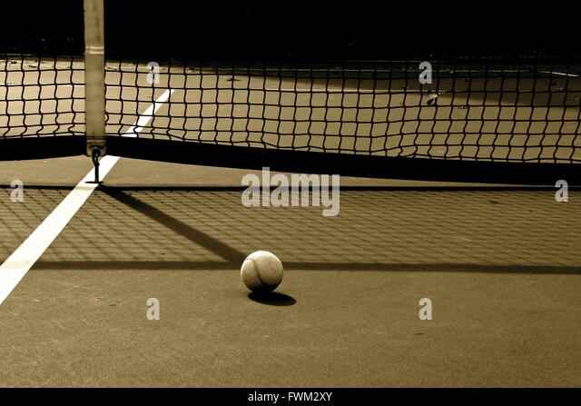 Tennis Ball Against Net At Court - Stock-Bilder