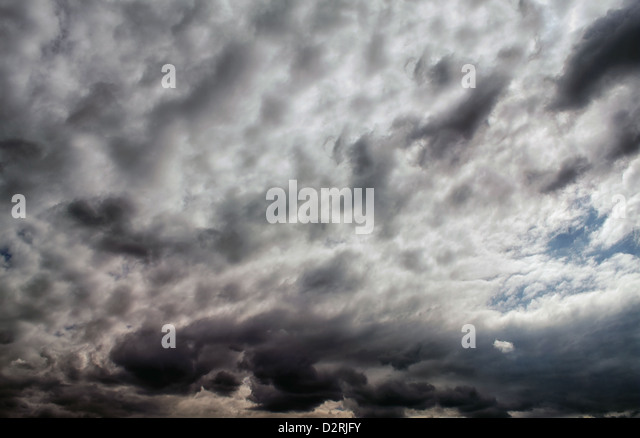 Sky background with violent and dramatic clouds - Stock Image