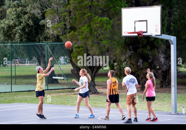 Brisbane Australia Queensland University of Queensland campus school education student teen boy girl playing basketball - Stock Image