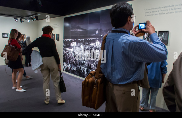 Paris, France, People Looking at Photo Exhibit, Art Show in City Hall Building, Archival Photos of Paris, by Robert - Stock Image