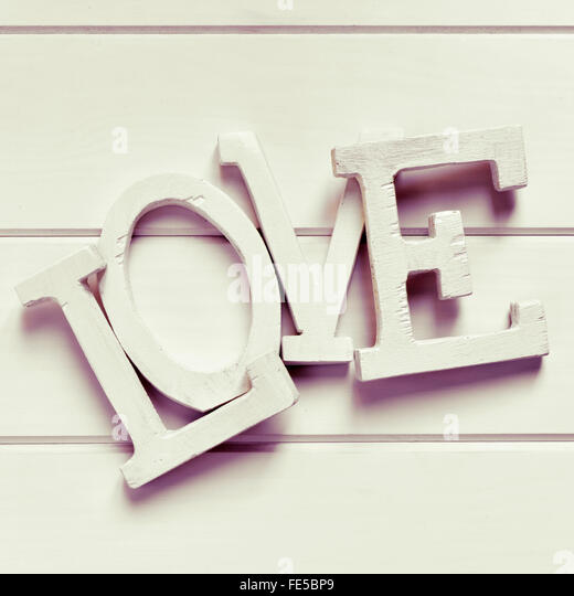 white three-dimensional letters forming the word love, on a white background, with a filter effect - Stock Image