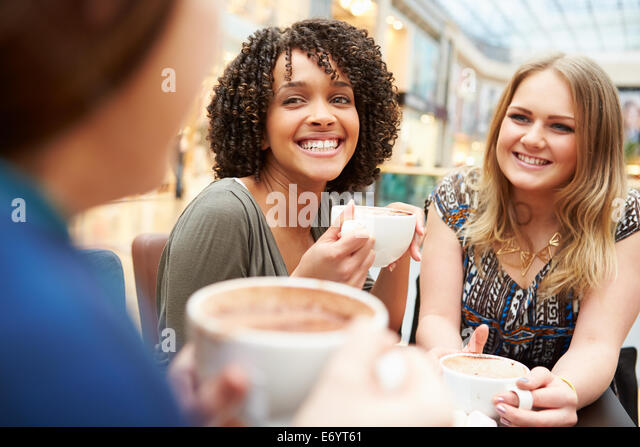 Group Of Young Female Friends Meeting In Café - Stock Image