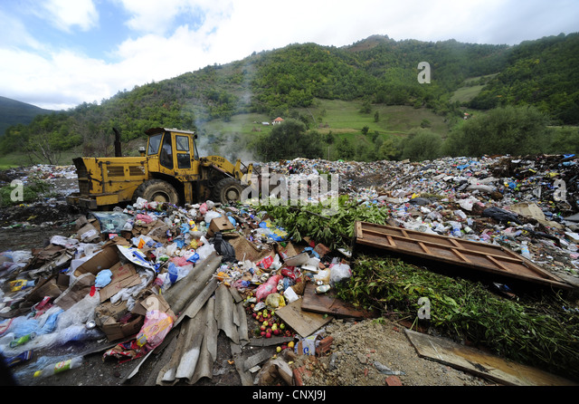 bulldozer on a waste disposal, Montenegro, Prokletije, Plavsk - Stock Image