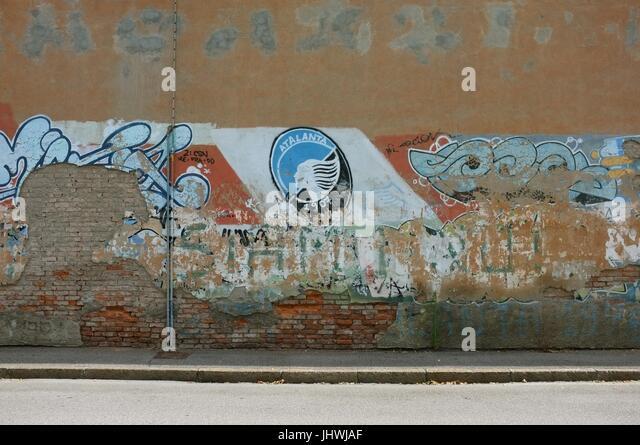 The Atalanta BC badge on a wall opposite Stadio Atleti Azzurri d'Italia in Bergamo, Lombardy, northern Italy, - Stock Image