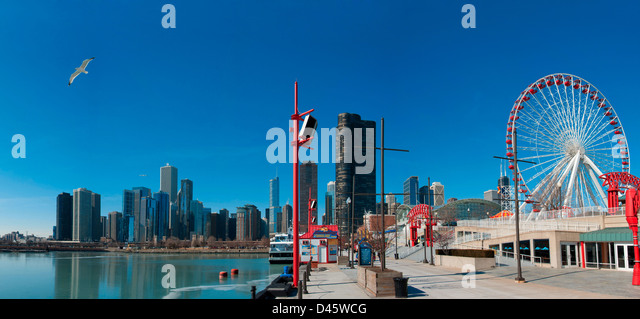 Chicago skyline seen from Navy Pier in February. Seagull flying on the left is a nice detail. - Stock Image