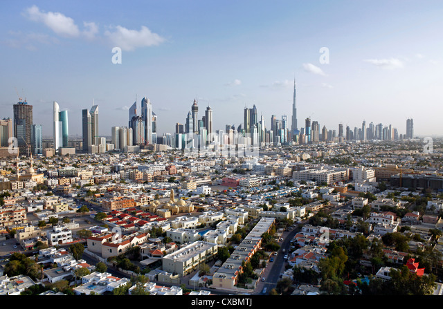 View of the new Dubai skyline of modern architecture and skyscrapers including the Burj Khalifa on Sheikh Zayed - Stock Image