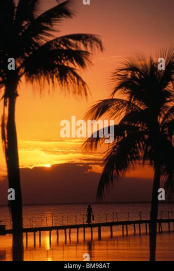 orange sky at sunset on the Isle of Youth Cuba - Stock Image