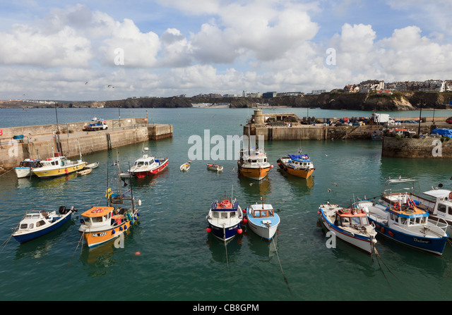 Newquay, Cornwall, England, UK, Britain. Fishing boats moored within the harbour wall - Stock Image