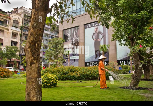 Contrast between 2 cultures. In HCMC - Stock-Bilder