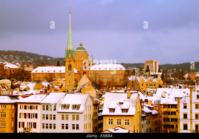 Switzerland Zurich panoramic view from Lindenhof to old city center in winter snow university - Stock Image
