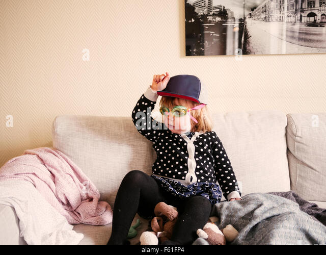 Girl having fun on couch - Stock Image