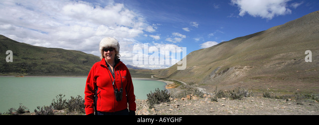 Tourist in Torres del Paine National Park in Patagonia in Southern Chile in South America - Stock Image