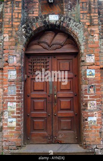 Doorway in Barrio Amon San Jose Costa Rica with tiles of Don Quixote - Stock Image