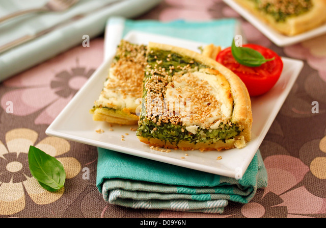 Puff pastry with spinaches and goat cheese. Recipe available. - Stock Image
