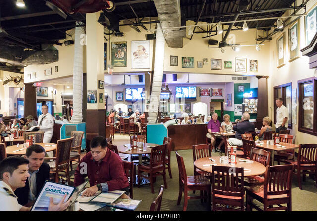 St. Saint Augustine Florida World Golf Village Murray Bros. Caddy Shack restaurant inside tables - Stock Image