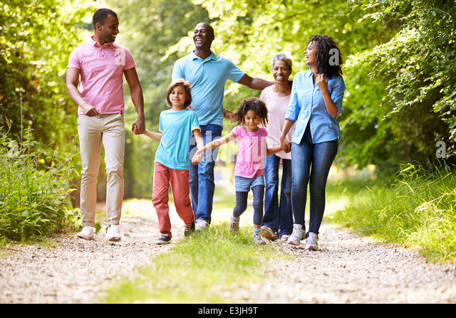 Multi Generation African American Family On Country Walk - Stock Image