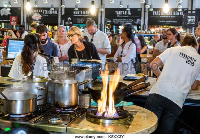 Portugal Lisbon Cais do Sodre Mercado Da Ribeira market hall food court dining Asian Lab restaurant kitchen pots - Stock Image